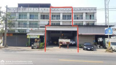 For SaleShophouseRangsit, Patumtani : Sell 3 and half storey commercial building, 2 booths, Lam Luk Ka, Canal 7, area of 27.8 square wah Price 9 million baht, very good location on the road.