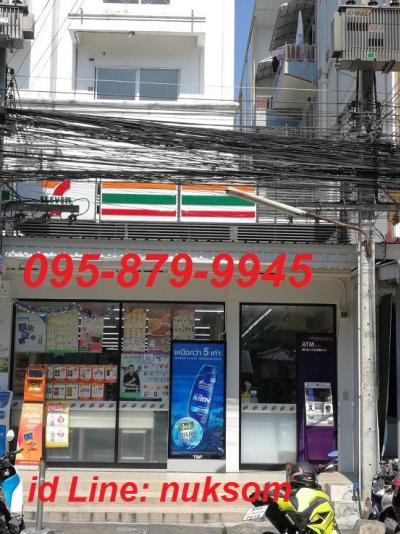 For SaleShophouseRangsit, Patumtani : Commercial building next to Bangkok University. Sale with a 7/11 lease. Corner room 48.5 sq.w.