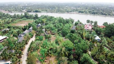 For SaleLandSamut Songkhram : Land for sale near Mae Klong River Beside Wat Thai Hat temple, an area of 6 rai