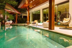 For SaleHouseSukhumvit, Asoke, Thonglor : 3 storey luxury house for sale, Soi Sukhumvit 63 or Ekamai 22, size 172 sq m., Area of 1,160 sqm., With private pool, elevator, decorated with good materials.