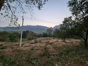 ขายที่ดินกาญจนบุรี : ขายที่ดิน 4 ไร่ ติดถนนเส้นขึ้นเขื่อน มีโฉนด เห็นวิวเขาชัด