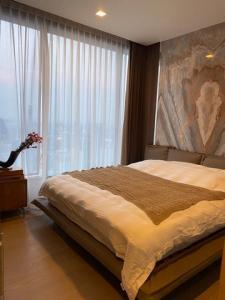 ขายคอนโดสุขุมวิท อโศก ทองหล่อ : ขาย/เช่าคอนโด The Esse Asoke ชั้น 47 ตกแต่งครบ 2 นอน 2 น้ำ 5.5 ตร.ม. วิวโรงเรียนวัฒนา
