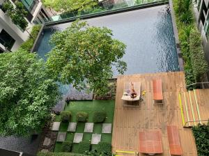 For SaleCondoSukhumvit, Asoke, Thonglor : Rhythm Sukhum36-38 for sale with tenants, beautiful room, good plan, cheap price, pool view, can be rented all the time, only 5.89 MB.