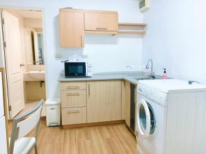 For RentCondoPattanakan, Srinakarin : Condo for rent, Prima Srinakarin, digital door with washing machine inside the room