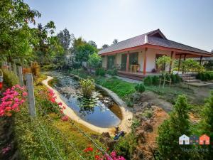 ขายบ้านเชียงใหม่-เชียงราย : บ้านสไตล์ minimal เงียบสงบริมสระน้ำ บนพื้นที่1ไร่ แวดล้อมด้วยสวนกว้างๆ ใกล้ตลาดและชุมชน