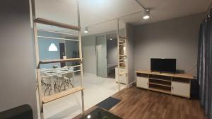 For RentCondoChengwatana, Muangthong : Popular Condo Muang Thong Building, P1 zone, 14th floor, room size 38 sqm. View in the building, 1 bedroom, 1 bathroom, living room zone, kitchen zone.