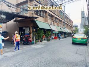 For SaleLandWongwianyai, Charoennakor : Land for sale with commercial buildings, Soi Taksin 8, near BTS Pho Nimit, only 100 meters.