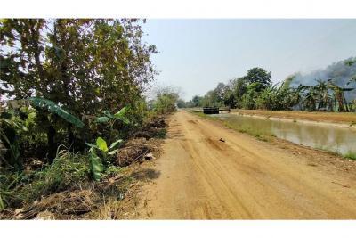 For SaleLandChiang Rai : ที่ดินติดถนนเลียบคลองชลประทาน(คลองหวาย)หลังสนามบิน
