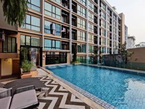 For RentCondoRatchadapisek, Huaikwang, Suttisan : For rent, Brown Condo, fully furnished, reduced strength, near MRT Huai Khwang