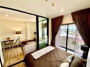 เช่าคอนโดวงเวียนใหญ่ เจริญนคร : Niche Mono เจริญนคร > วิวโค้งแม่น้ำเจ้าพระยาเต็ม ห้อง1 bed plus มีห้องทำงาน !