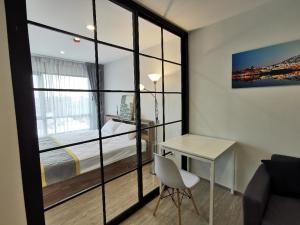 ขายคอนโดวิภาวดี ดอนเมือง หลักสี่ : ขาย Reach Phaholyothin 52 แบบ 1 bed ขนาด 30.19 ตร.ม. ชั้น 4 ระเบียงทิศใต้ วิวโล่ง อาคาร F ตึกเกียวที่มีส่วนกลาง